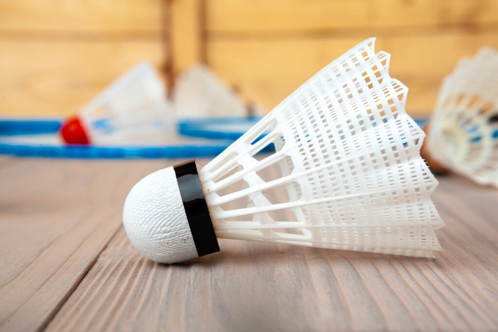 Badminton equipment. Rackets and shuttlecock on wooden table